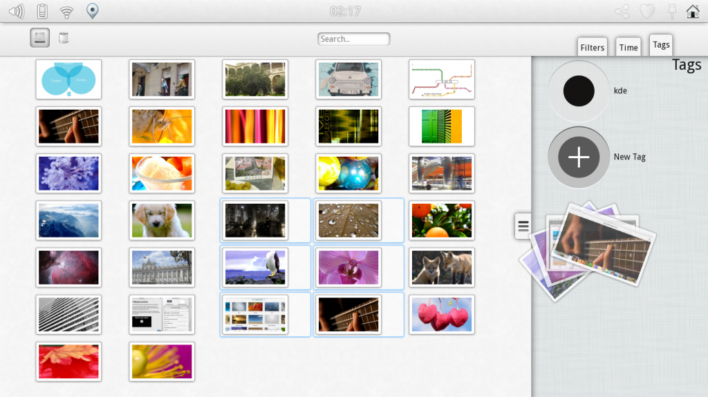 Plasma Active 3 file manager displaying images and tags